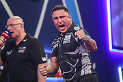 Gerwyn Price hits a 180 during the PDC William Hill World Darts Championship at Alexandra Palace, London, United Kingdom on 19 December 2019.