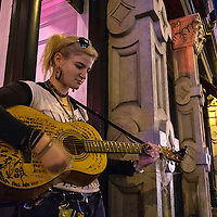 A street performer plays songs for money in the street on Music Row in downtown Nashville, Tennessee on Friday, November 13, 2015. (Alex Menendez via AP)
