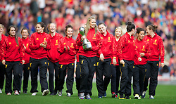 LIVERPOOL, ENGLAND - Saturday, October 5, 2013: Liverpool Ladies captain Gemma Bonner holding the Women's Super League trophy as the team parade around at Anfield. (Pic by David Rawcliffe/Propaganda)