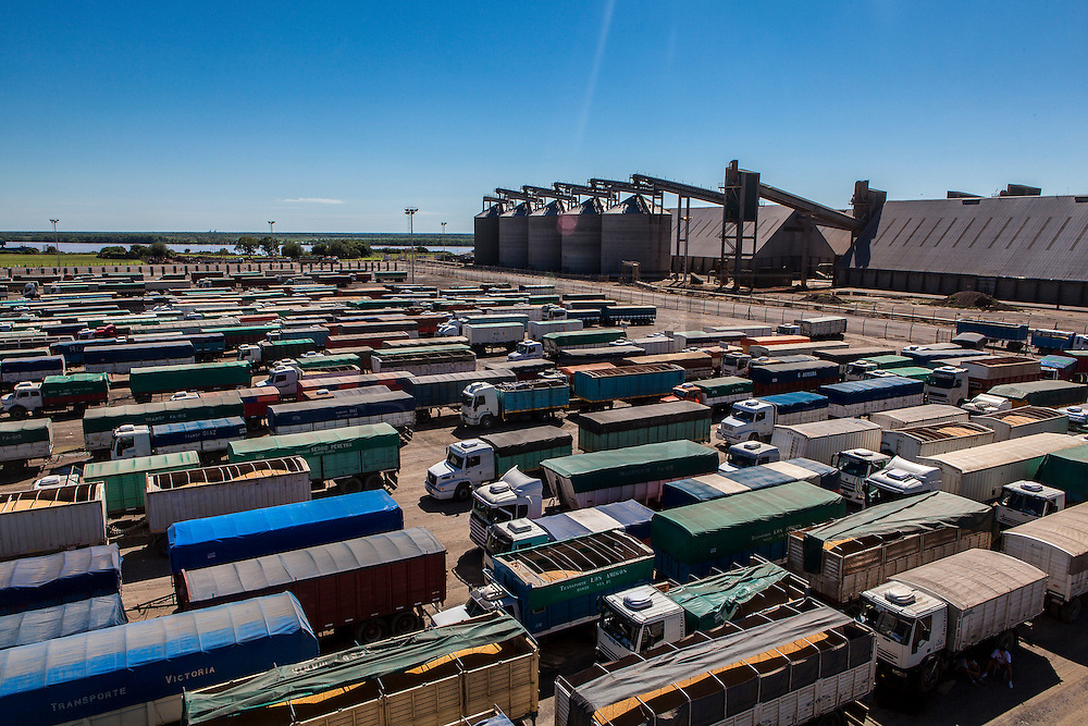 2015/03/06 – San Lorenzo, Argentina: Trucks await for their turn to be weighted and have the quality of their cargo checked at Terminal 6 of the General San Martín Port.  Around 1,300 trucks deliver grains at Terminal 6, representing 40,000 tons a day, which is half of the capacity that the port can recive in one single day. Terminal 6 is the largest of its kind in South America where 80,000 tons per day are received by trucks, trains and boats. The grains are then process at the plant located at the port and then shipped worldwide. (Eduardo Leal)