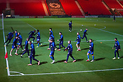 AFC Wimbledon players warming up during the The FA Cup match between Doncaster Rovers and AFC Wimbledon at the Keepmoat Stadium, Doncaster, England on 19 November 2019.