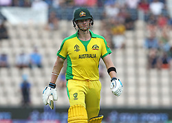 Australia's Steve Smith looks dejected as he leaves the field after being caught and bowled by England's Tom Curran during the ICC Cricket World Cup Warm up match at The Hampshire Bowl, Southampton.