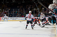 KELOWNA, CANADA - JANUARY 30: Elijah Brown #15 of the Medicine Hat Tigers his checked by Kyle Topping #24 of the Kelowna Rockets on January 30, 2017 at Prospera Place in Kelowna, British Columbia, Canada.  (Photo by Marissa Baecker/Shoot the Breeze)  *** Local Caption ***
