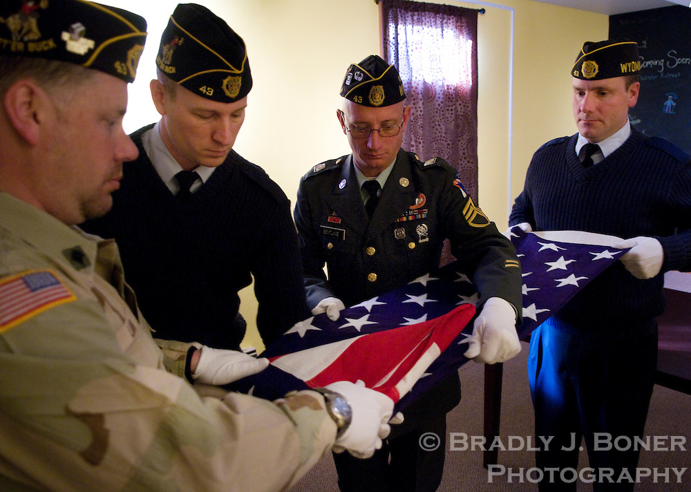 NEWS&GUIDE PHOTO / BRADLY J. BONER.Dennis Lamb, Dave Taylor, Dave Bentlage and Tom Lamb V practice folding the flag in a small room in the basement of First Baptist Church before the memorial service.