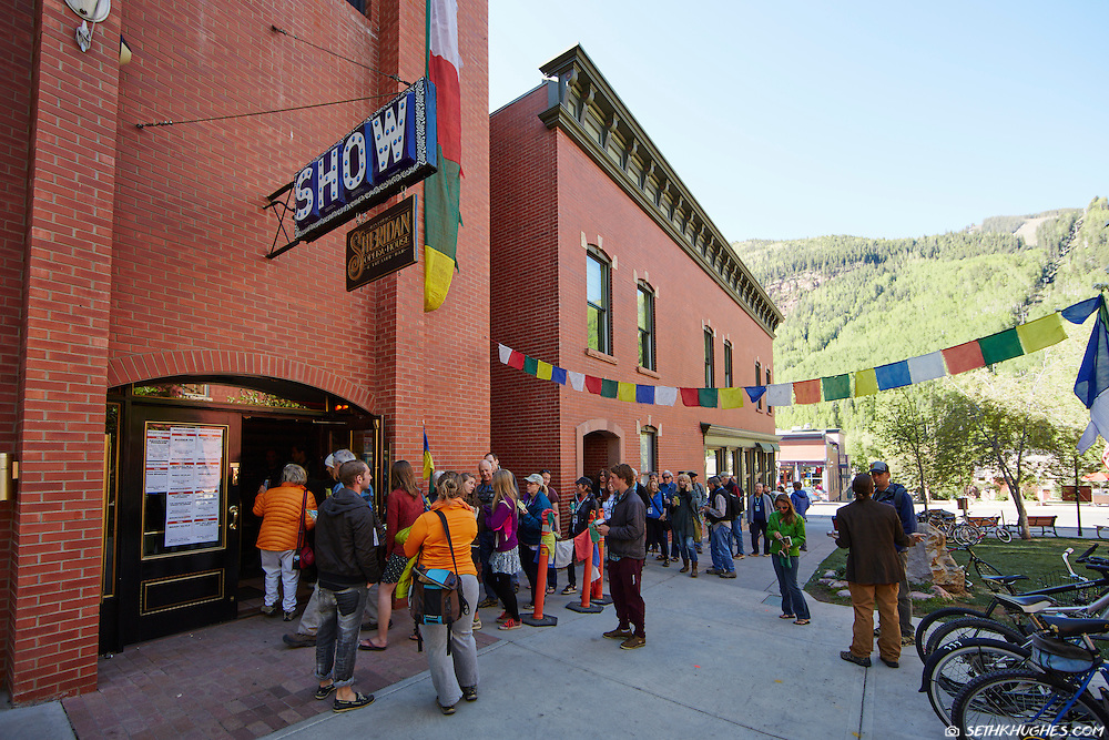 At a film festival in Telluride, Colorado, visistors queue up in front of the Sheridan Opera House waiting for a show to begin.