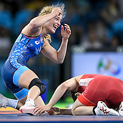 Helen Maroulis, in blue, reacted to earning the United States its first Olympic gold in women's wrestling in dramatic fashion, defeating three-time Olympic champion Saori Yoshida of Japan Thursday evening at Carioca Arena 2 during the 2016 Summer Olympics Games in Rio de Janeiro, Brazil.
