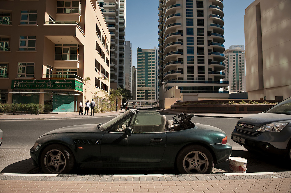 An abandoned BMW lies parked in the Dubai Marina locality in Dubai, UAE on February 10, 2010 Archive of images of Dubai by Dubai photographer Siddharth Siva