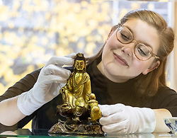 The Bonhams Asian Art Sale takes place on Thursday 15 November at 22 Queen Street Edinburgh starting at 11 am. It features Japanese and Chinese Art including: bronzes, jades, snuff bottles, porcelain, textiles, lacquer, paintings and furniture.<br /> <br /> Pictured: A gilt bronze group of Guanyan and Sudhana valued between &pound;6,000 and &pound;7,000 viewed by Jaine Heggie of Bonhams