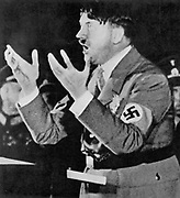 Adolph Hitler (1889-1945), German dictator, addressing a rally Nazi party rally at Munich.