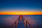 Pier (dock) on Lake Winnipeg at dawn<br />