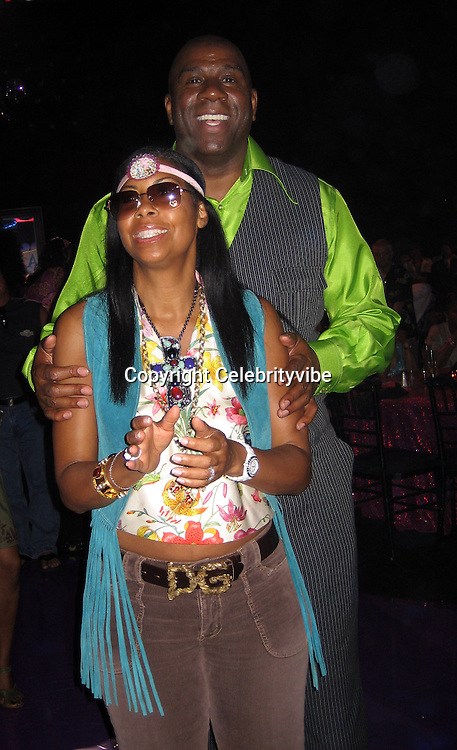 **EXCLUSIVE**.Magic Johnson with wife.Silly 70's Party with performances by Aerosmith, Earth Wind, Fire & Village People & Stevie Wonder.Opening of Cain at The Cove Hotel.Grand Ballroom.Atlantis Hotel.Paradise Island, Bahamas.Saturday, May 12, 2007 .Photo By Celebrityvibe.To license this image please call (212) 410 5354; or.Email: celebrityvibe@gmail.com ;.
