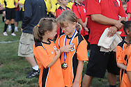 FALLS TOWNSHIP, PA - SEPTEMBER 06: Carlee Parzyzk (L) and Kaitlyn Tuliback share a smile during the opening day parade of Falls Soccer Club September 6, 2014 at Falls Community Park in Falls Township, Pennsylvania. (Photo by William Thomas Cain/Cain Images)