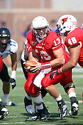 15 September 2012:  Matt Brown hands off to Jordan Neukirch during an NCAA football game between the Eastern Illinois Panthers and the Illinois State Redbirds at Hancock Stadium in Normal IL