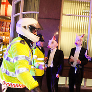 8 men dressed in tuxedos and wearing pigs heads tried to join the Lord Mayor's Banquet in London, pointing out that the banquet is for the 1 % of society and not the 99%..No arrests were made and the pig headed party goers went to St Paul to have their own banquet.