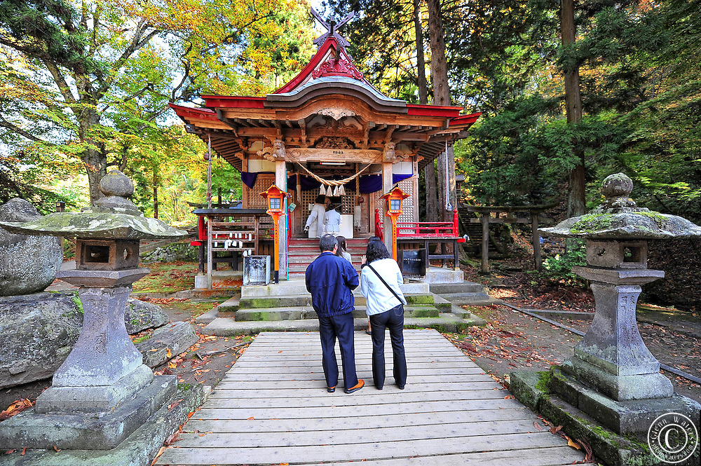 Nakano Momijiyama shrine on the side of a mountain in Kuroishi northern Japan.People praying at this ancient shinto shrine in the fall.