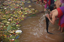 May 4, 2019 - Kathmandu, Nepal - Nepalese Devotees takes ritual holy bath during the Mother's Day to perform puja at Matatritha temple in Kathmandu, Nepal on Saturday, May 04, 2019. Mother's day or Matatritha Aunshi is celebrated on Baishak Krishna Ausi according to Lunar calendar. On this auspicious day, people pay homage to their mothers giving her gifts and foods including sweets and fruits. Those who have already lost his/her mother visit Matatritha Temple. People take holy dip on the sacred pond at Mata Tirtha. They also perform different  rituals and praying during this day. (Credit Image: © Narayan Maharjan/NurPhoto via ZUMA Press)