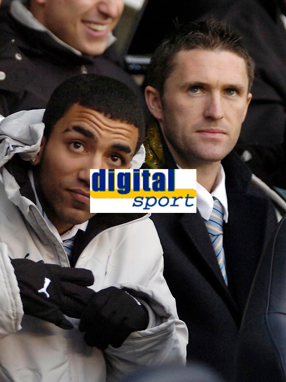 Photo: Ed Godden.<br /> Tottenham Hotspur v Aston Villa. The Barclays Premiership. 26/12/2006. Spurs players Aaron Lennon and Robbie Keane watch the game from the bench.