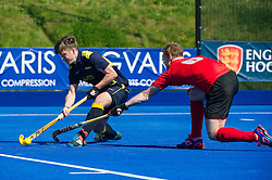 Team Bath Buccaneers' Matthew Boote is tackled by Dan Coultas of Holcombe.  Holcombe v Team Bath Buccaneers - Now: Pensions Finals Weekend, Lee Valley Hockey & Tennis Centre, London, UK on 12 April 2015. Photo: Simon Parker