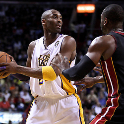 March 10, 2011; Miami, FL, USA; Los Angeles Lakers shooting guard Kobe Bryant (24) is guarded by Miami Heat shooting guard Dwyane Wade (3) during the second quarter at the American Airlines Arena.  Mandatory Credit: Derick E. Hingle