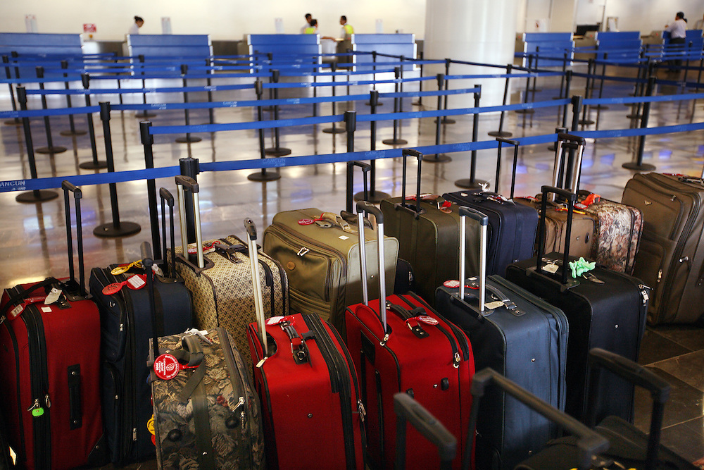Guidelines and luggage sit in the Airport of Cancun, Mexico. The area is world-renowned for its beautiful beaches, resorts, sport fishing, and diving opportunities.