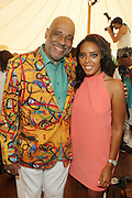 Water Mill, New York: (L-R) Visual Artist Danny Simmons and Television Personality Angela Simmons attend the RUSH Philanthropic Arts Foundation 15th Annual Art For Life Benefit Gala held in the Hamptons at the Farmview Farms on July 26, 2014  in Water Mill, New York. (Terrence Jennings)