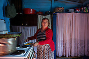 The Cesmin Lug camp is home to approximately 300 Ashkali/Roma IDP's, who mainly come from the Roma Mahala in the southern part of Mitrovica. After the Kosovo Conflict, the Romas, Ashkalis and Egyption Romas was expelled from their homes by Kosovo Albanians, who destroyed their homes. Cejniea Nishlia prepares lunch in her kitchen.