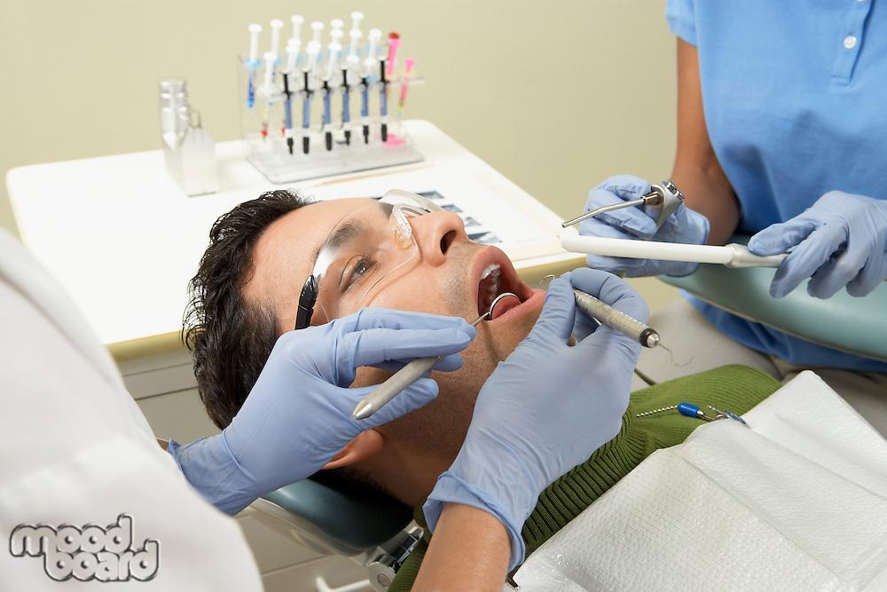 Man Getting Dental Work Done