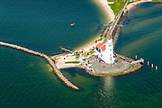 Nederland, Noord-Holland, Marken, 05-08-2014; vuurtoren van het (voormalig) eiland Marken met de bijnaam Paard van Marken. Het omliggende water is het Markermeer (IJsselmeer, Zuiderzee)<br /> Lighthouse on the the former island of Marken, now connected with a causeway (dam) to the mainland.<br /> luchtfoto (toeslag op standard tarieven);<br /> aerial photo (additional fee required);<br /> copyright foto/photo Siebe Swart