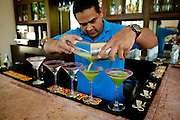 "A bartender at the Casa Sauza distillery in Tequila pours ""tequinis"" for visitors."