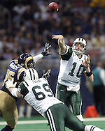 New York Jets quarterback Chad Pennington (10) gets the ball off down field under pressure from St. Louis Rams defensive end Anthony Hargrove (95), during the first half of the Rams 32-29 overtime win in St. Louis, Missouri, January 2, 2005.