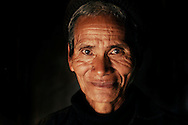 Burma/Myanmar. Portrait of a smiling man from the Akha tribe.
