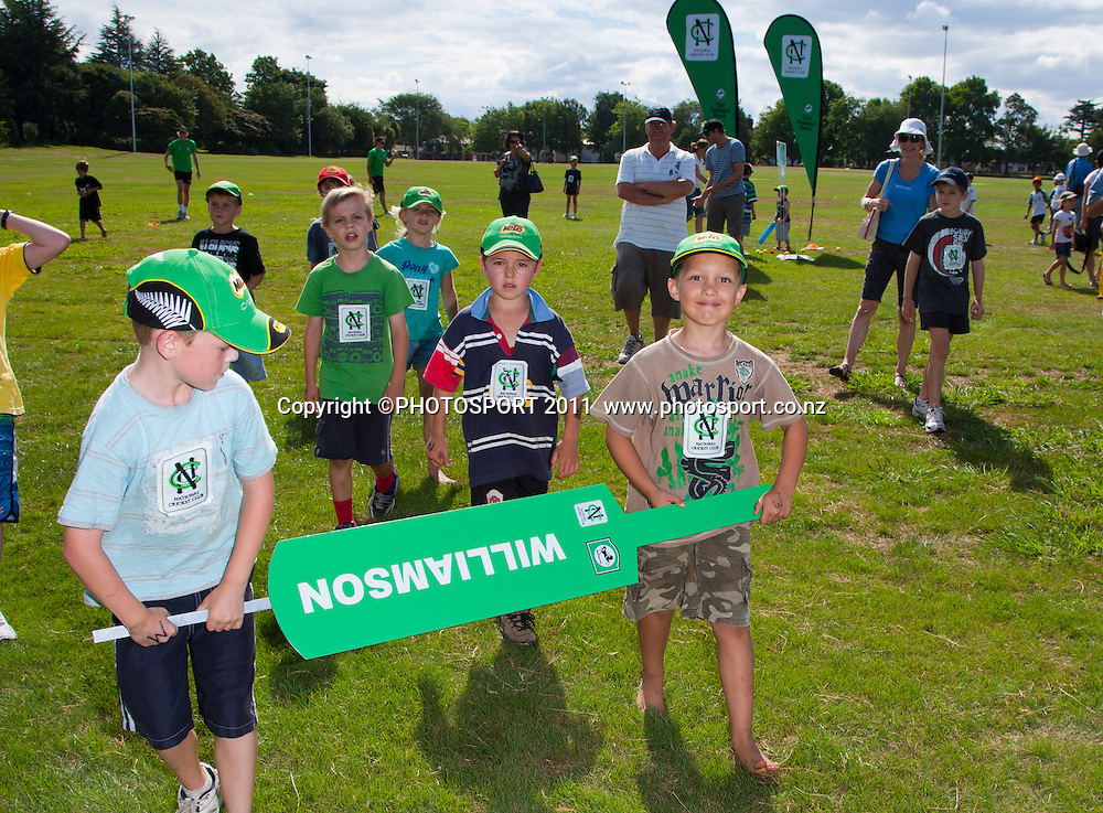 Teams head to skills sessions during the NCC Super Camp for Primary School players, an initiative by The National Bank to connect with the grass roots of cricket, hosted by Hamilton Star University Cricket Club, Waikato University, Hamilton, New Zealand, Wednesday 5 January 2011. Photo: Stephen Barker/PHOTOSPORT