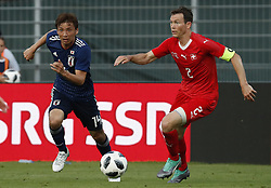 LUGANO, June 9, 2018  Switzerland's Stephan Lichtsteiner (R) vies with Japan's Takashi Inui during the international friendly match at the Stadium Cornaredo in Lugano, southern Switzerland June 8, 2018. Switzerland won 2-0. (Credit Image: © Ruben Sprich/Xinhua via ZUMA Wire)