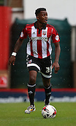 Josh Clarke (Brentford midfielder) on his own looking up and trying to pick his pass during the Sky Bet Championship match between Brentford and Reading at Griffin Park, London, England on 29 August 2015. Photo by Matthew Redman.