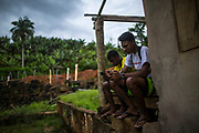 Two teenagers enter the Poça Quilombo to use the wifi signal as they come back from school in Eldorado, south of Sao Paulo, Brazil, Monday, Nov. 26, 2018. (Dado Galdieri)