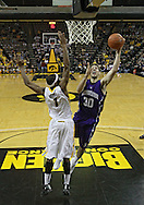 January 12 2010: Northwestern Wildcats forward Davide Curletti (30) puts up a shot past Iowa Hawkeyes forward Melsahn Basabe (1) during the first half of an NCAA college basketball game at Carver-Hawkeye Arena in Iowa City, Iowa on January 12, 2010. Northwestern defeated Iowa 90-71.