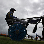 Horse and riders in the parade ring during the Winton Harness Racing Club Race meeting at the Central Southland Raceway, WInton, Southland, New Zealand. 10th February 2012. Photo Tim Clayton