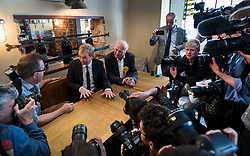 © Licensed to London News Pictures. 07/06/2017. Twickenham, UK. Liberal Democrat leader Tim Farron speaks with the owner of a wine bar with local candidate Vince Cable as they campaign together in Twickenham on the last day of the election before the polls open. Photo credit: Peter Macdiarmid/LNP