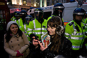 Young teenage girl students during protest against government education cuts in Trafalgar Square. Holding a variety of splinter marches that denounce the coalition government's policy of charging extra higher-education tuition fees. There were isolated incidents of violence and skirmishes with police, mostly in central London.