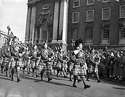 17/03/1955<br /> 03/17/1955<br /> 17 March 1955<br /> St. Patrick's Day Industrial parade in Dublin, run by the N.A.I.D.A.. Female piper band passes the corner of Trinity College as part of the parade.