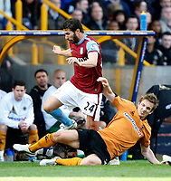 Photo: Steve Bond/Richard Lane Photography. Wolverhampton Wanderers v Aston Villa. Barclays Premiership 2009/10. 24/10/2009. Carlos Cuellar (L) is tackled by Kevin Doyle