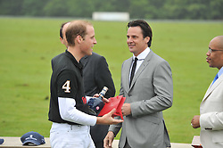 Left to right, HRH The DUKE OF CAMBRIDGE and ERIC DEARDORFF CEO of Garrards at the Sentebale Polo Cup held at Coworth Park, Berkshire on 12th June 2011.