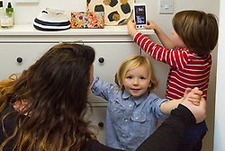 REACH PLC: Olivia Squier with sons Hugo and Rudy with her smart meter at her Camberwell Home in London. LONDON, December 13 2018.