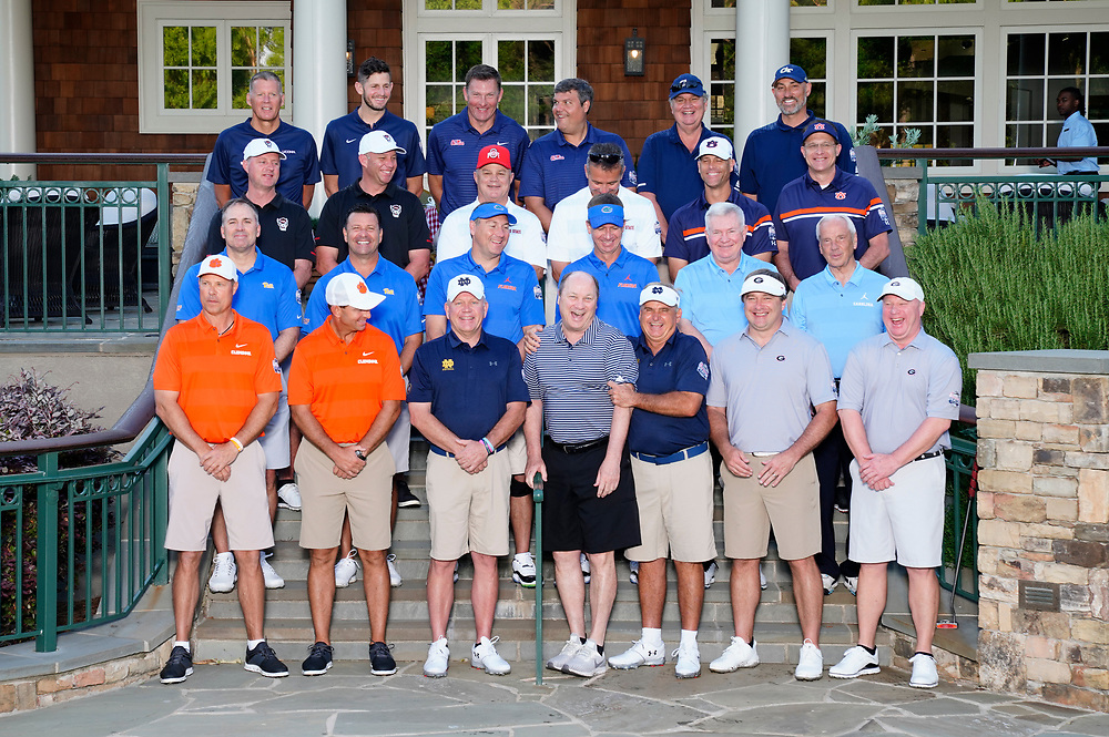 Coaches group along with Peach Bowl, Inc. CEO & President Gary Stokan prior to the during the Chick-fil-A Peach Bowl Challenge at the Ritz Carlton Reynolds, Lake Oconee, on Tuesday, April 30, 2019, in Greensboro, GA. (Paul Abell via Abell Images for Chick-fil-A Peach Bowl Challenge)