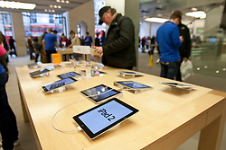 © licensed to London News Pictures. London, UK 07/03/2012. Customers of Apple Store, Regent Street are using the current Apple iPad 2 as they wait for Apple's presentation which is expected to reveal a new iPad model this evening. (07/03/12). Photo credit: Tolga Akmen/LNP