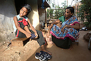 Budhia Singh, (left) 6, the famous Limca World Record marathoner, is preparing to train near his home in Salia Sahi slum (pop. 30.000) of Bhubaneswar, the capital of Orissa State, on Sunday, May 18, 2008. On May 1, 2006, Budhia completed a record breaking 65 km run from Jagannath temple, Puri to Bhubaneswar. He was accompanied by his coach Biranchi Das and by the Central Reserve Police Force (CRPF). On 8th May 2006, a Government statement had ordered that he stopped running. The announcement came after doctors found the boy had high blood pressure and cardiological stress. As of 13th August 2007 Budhia's coach Biranchi Das was arrested by Indian police on suspicion of torture. Singh has accused his coach of beating him and withholding food. Das says Singh's family are making up charges as a result of a few petty rows. On April 13, Biranchi Das was shot dead in Bhubaneswar, in what is believed to be an event unconnected with Budhia, although the police is investigating the case and has made an arrest, a local goon named Raja Archary, which is now in police custody. **Italy and China Out**