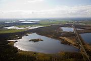 Nederland, Noord-Holland, Naarden, 16-04-2008; Naardermeer: oudste en een van de bekenste natuurreservaten van Nederland, bezit van de Vereniging voor Natuurmonumenten (grondlegger Jac. P. Thijsse); foto in westelijke ring , Weesp en Bijlmermeer  (Amsterdam-Zuidoost) rechts aan de horizon; momenteel wordt het gebied uitsluitend doorsneden door de spoorlijn, er zijn echter plannen om een nieuwe weg aan te leggen tussen het nabij gelegen Almere en Amstelveen / Schiphol, in verband met de fileproblematiek rond de hoofdstad; Rijkswaterstaat overweegt echter de Gaasperdammerweg te verbreden ivm die files en zo het Naardermeer te sparen;..luchtfoto (toeslag); aerial photo (additional fee required); .foto Siebe Swart / photo Siebe Swart