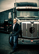 """CENTRAL CITY, Ky. - Caleb Barlow, Vice President of Threat Intelligence for IBM, poses for a portrait outside X-Force Command, IBM's """"mobile cyber range"""" to use in corporate cybersecurity training."""