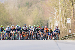 The peloton aren't far behind Gracie Elvin on the first time up the climb  - 2016 Omloop van het Hageland - Tielt-Winge, a 129km road race starting and finishing in Tielt-Winge, on February 28, 2016 in Vlaams-Brabant, Belgium.