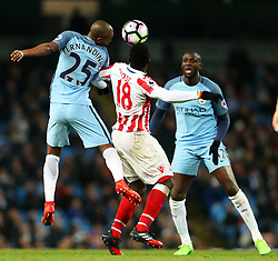 Fernandinho of Manchester City challenges Mame Biram Diouf of Stoke City - Mandatory by-line: Matt McNulty/JMP - 08/03/2017 - FOOTBALL - Etihad Stadium - Manchester, England - Manchester City v Stoke City - Premier League